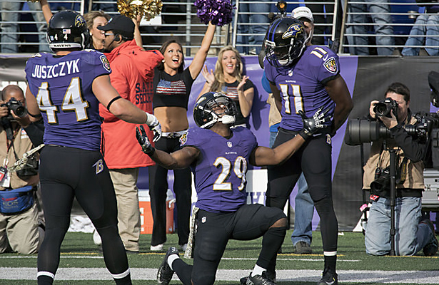 Running back Justin Forsett of the Baltimore Ravens celebrates a touchdown against the Tennessee Titans at M&T Bank Stadium on November 9, 2014 in Baltimore, Maryland. Photo Courtesy: Keith Allison