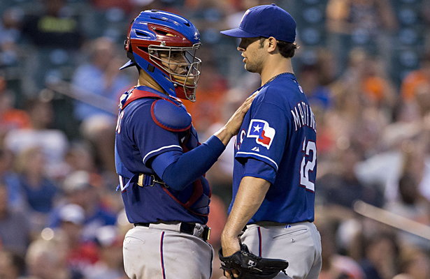 Rangers catcher Robinson Chirinos and Nick Martinez discuss strategy. Photo Courtesy: Keith Allison