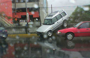Note to self: Do not allow the intern to parallel park the Range Rover ever again. Photo Courtesy: Eperales