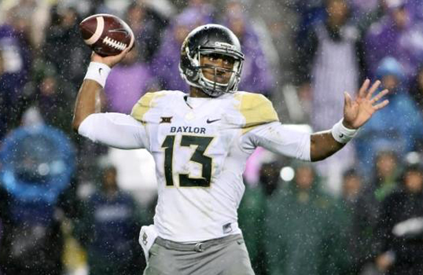 Baylor Bears QB Chris Johnson battled the weather to complete 7 of 24 passes for 62 yards with a TD and an interception. Photo Courtesy: Dominic Ceraldi