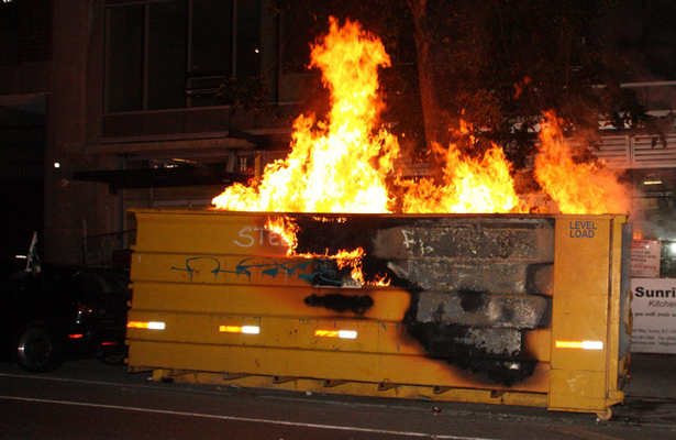 This image of a dumpster fire is probably the correct description of the football programs in Austin and College Station. Photo Courtesy: Brian Neumann