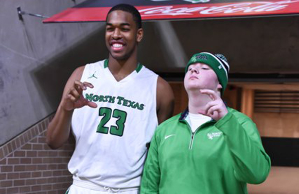 Rickey Brice Jr. and a UNT fan showing some school spirit. Photo Courtesy: Bruce Chandler