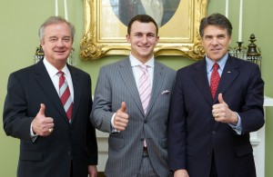 This picture captures the height of success for Johnny Manziel flanked on left by Texas A&M Chancellor John Sharp and on the right by former Texas Governor Rick Perry. Photo Courtesy: Governor Rick Perry