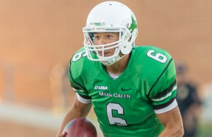 Quarterback Mason Fine running for a first down at the Bethune-Cookman University vs University of North Texas football game at Apogee Stadium, Denton, Texas on September 10, 2016. Photo courtesy of Sandy McAnally