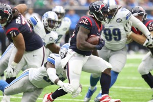 Houston RB Lamar Miller rushes for yardage against the Lions in Sunday's victory.  The Texans scored two touchdowns in the first half and held on in the second half to remain in first place in the AFC South.