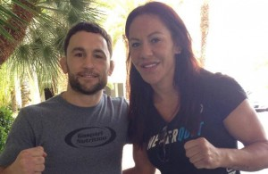 Frankie Edgar (l.) and Cris Cyborg (r.) strike a pose for UFC fans. Photo Courtesy: Sal Ami
